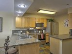 Step around the corner into the fully equipped kitchen.