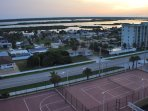 Sunset from your back balcony - tennis, basketball and shuffleboard courts