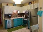 Newly remodeled & stocked kitchen with new appliances and quartz counters.