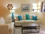 Comfortable new couch and chair.  Bright & Cheery!