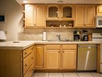 Fully equipped kitchen with standard coffee maker and dish washer