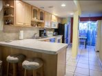 Fully equipped kitchen with seating for 2 at the brekffast counter, standard coffee maker, dish washer & dinette with...