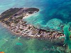 Caye Caulker from above. Our house is right where the slight indentation is at the top left.