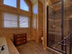 Master bath with walk-in shower and Jacuzzi tub