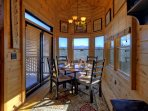 Dining area has bay window views of mountains.