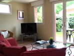 Lounge equipped with LCD 403 TV, receiving UK Freeview and French TNT channel. DVD player and WiFi.