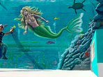 Famous Artist Danny Torres painted this lovely sealife mural on the front of the house.