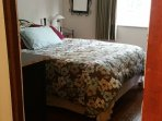 A quality queen bed in the main bedroom