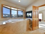 Large soak tub with amazing views in master bathroom