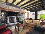 Farmhouse cottage - lounge with inglenook fire place near Caernarfon