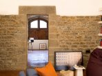 The thick Medieval wall separating the entrance from the living area