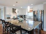 Kitchen with Center Island, Breakfast Bar, Stainless Appliances