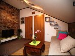 Living Room with Comfortable Sofa and LCD TV