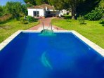 Huge deep pool in stunning Andalusian country setting, with distant sea views to the Atlantic