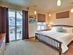 The bright and spacious bedroom offers an amazing view and cozy bed.