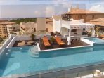 rooftop heated salt water pool and jacuzzi on to of penthouse