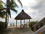 Tiki huts, palm trees and sandy beach