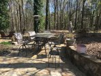 The patio with fire pit and outdoor pizza oven.