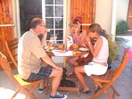 Previous guests The Wallace family enjoying a meal by the pool!