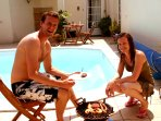 Previous guests Andrew and Zoe enjoying a barbecue by the pool!