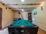 Enjoy a game of pool or darts in the tavern