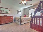 This bedroom has a queen-sized bed a twin-over-full bunk beds.