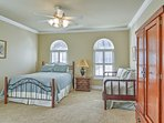 This room features sleeping for 4 guests with a queen bed and twin daybed set.