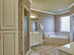 The en-suite master bathroom features a Jacuzzi tub.