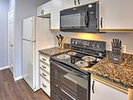 The fully equipped kitchen boasts granite counters.