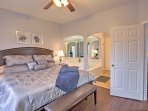 The master bedroom features a king bed and en-suite bathroom.