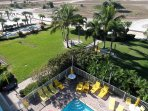 Another view from our balcony over our  premises, including the pool, lush gardens, shuffle board.