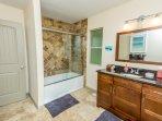 Master bathroom: heated tile flooring, granite counters, shower/tub
