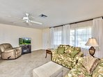 Living Room with Ample Couch Seating and Flat Screen TV!