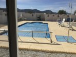 View of private solar-heated pool and mountains from bedroom patio doors.
