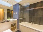 Family bathroom with slate grey, blue and gold