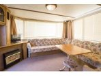Lounge area in our 6 berth caravan located at Heacham beach.