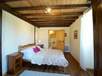 Bedroom with double bed and private en suite shower room and toilet