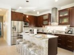 Large chefs kitchen with an oversized island. Perfect for family breakfast!