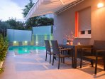 Private terrace with a pool area and dinning table!