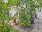 Sit back in tropical gardens and soak in a multi-lighted swim spa while staying at this lovely 2-bedroom, 1-bath...
