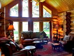 Cozy living rm, vaulted ceilings, gas fire stove, glam rugs.  Faces Badrock Canyon which lights up.