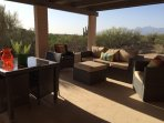 Back patio with mountain views, foreground views of desert and its multi-armed saguaros-very peaceful place to relax!