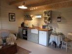 Cuttermoon Lodge has a well equipped kitchen including a fridge with ice compartment, gas cooker/hob