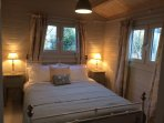 Cuttermoon Lodge has a sumptuous double bedroom, kingsize bed and silk curtains that add luxury.