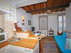livingroom with bed coach, balcony sea view, kitchen corner