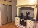 Kitchen fully equipped with freezer, cooler and stove with inductive hobs