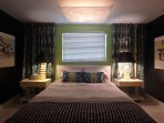Master bedroom features a King bed and en suite bathroom