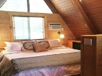 King bed in loft with built in Flat screen TV.