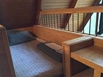 Twin bed and built in desk in the loft