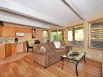 Ground level boasts both a family room and a half kitchen
